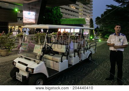 Yalta, Crimea - 11 July, The driver at the golf-car, 11 July, 2017. Night surroundings and adjoining territories of hotel Yalta Intourist.