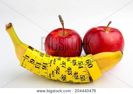 banana with centimeter and apples, fitness, diet, vitamins, healthy food, fruit