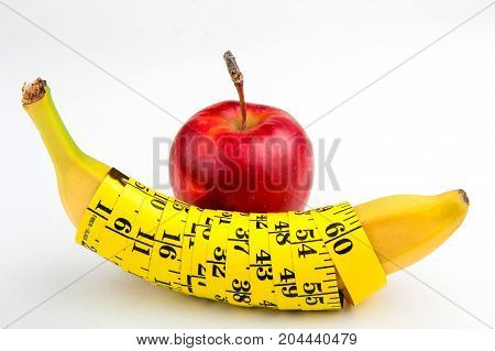 banana with a centimeter and apple, fitness, diet, vitamins, healthy food, fruit