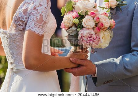 Newlyweds exchange rings, groom puts the ring on the bride's hand. wedding ceremony. bride and groom