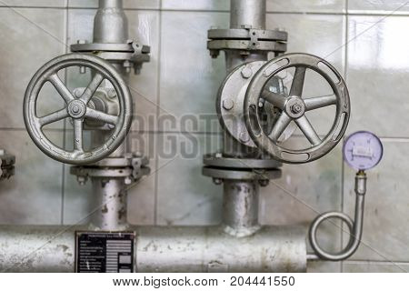 Handle valve with steel pipe in industrial plant.
