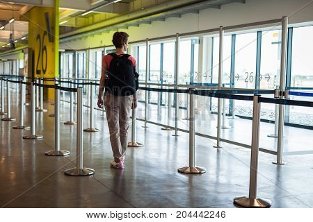 Young Woman With Luggage Waiting In The Airport Hall Her Plane