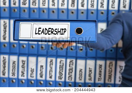 Leadership concept. Leadership skill concept. Young man holding ring binder.
