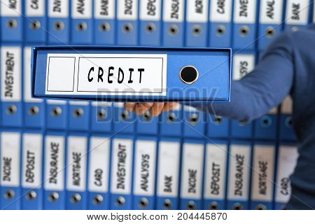 Credit card line investment balance concept. Young man holding ring binder.