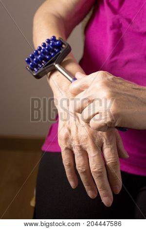 Elderly self massaging the body for pain
