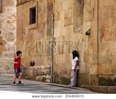 Salamanca, Spain - May 7, 2014: Kids playing in downtown of Salamanca, Spain