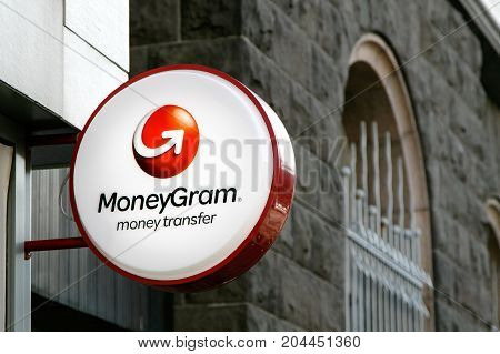 Reykjavik Iceland August 22 2017: MoneyGram sign is mounted to a wall above the entrance to their branch.