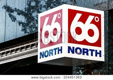 Reykjavik Iceland August 22 2017: 66 degrees North sign is attached to the wall above the entrance to the retail clothing store.