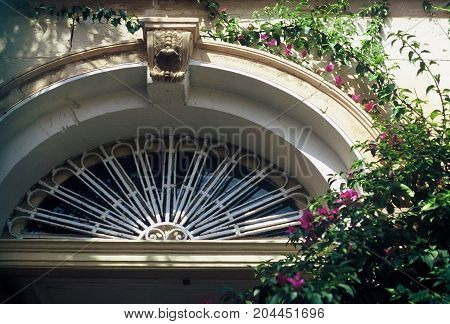 Adorning architectural detail above a door of a historic building