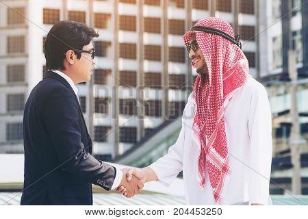 Arab Man And Businessman Handshake