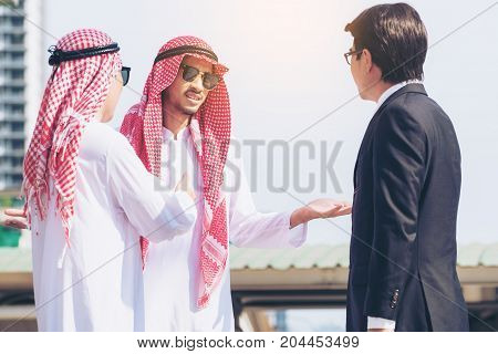 Arabic, Asian, Mexican Businessmen Business Meeting