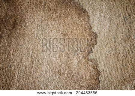The texture of old dirty doormat with stain