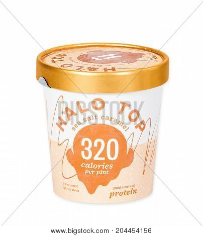 DALLAS TEXAS - AUGUST 29 2017: A pint of Halo Top a high-protein low-sugar and low-calorie Ice Cream in sea salt caramel flavor isolated on white background. The diet-friendly Halo Top Creamery ice cream was launched in 2012.