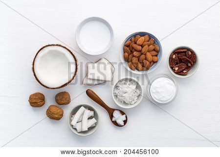 Homemade Skin Care Products On White Wooden Table Background. Coconut, Oil, Walnut, Almond, Scrub, M