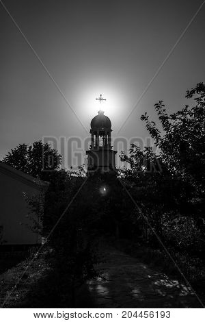 Orthodox monastery of St. George. The bell tower above the Sacred source of water. Pomorie. Bulgaria. Black and white.