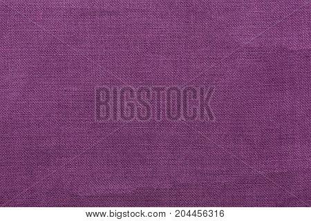purple burlap background and texture, The texture of the burlap, closeup