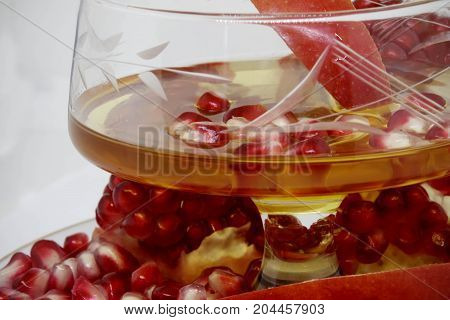 Honey and pomegranate on white background. Jewish New Year - Rosh Hashana concept. Space for text