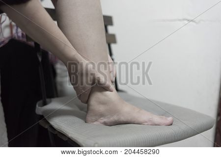 sport injury concept woman suffering from an ankle injury while exercising and running.
