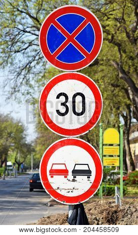 Road signs next to the street in the city