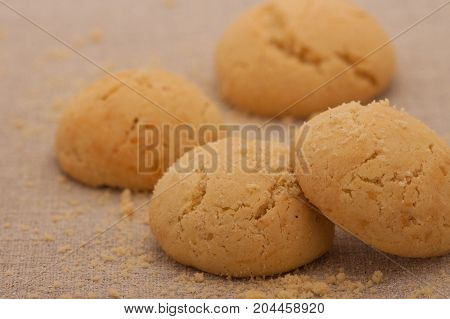 close up of oatmeal cookies round shape with crumbs