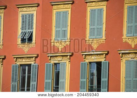 Terracotta colored historic palace on Place Garibaldi in Nice, France