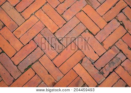 The old vintage brick walkway for texture or background.