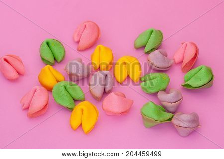 Many Colored Cookies On A Pink Background
