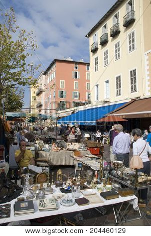 Nice, France - October 2012: Flea market in old part of Nice with people walking along the stands in 2012
