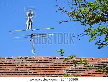 Television antennas on the roof of a house
