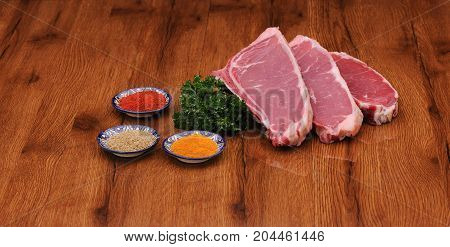 Raw Meat On The Board With Spices