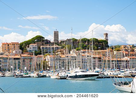 Cannes, ITALY - September 18, 2016: Le Vieux Port of Cannes. Harbour and old city at the French Riviera, home for the Cannes Film Festival