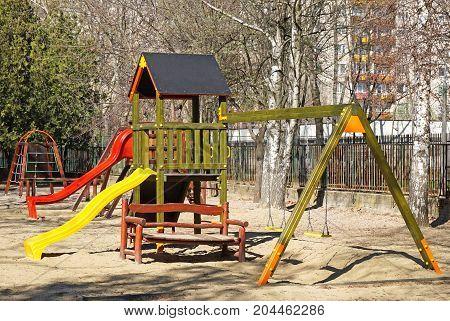 Slides and jungle gym at yard of the kindergarten