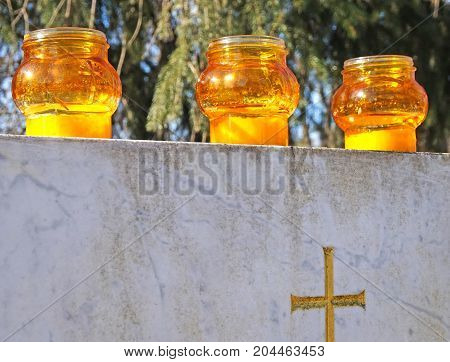 Lampions on the tombstone in the public cemetery
