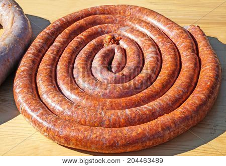 Raw sausages on a table ready to cook