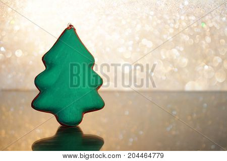 beautiful figurine green spruce on a brilliant white background