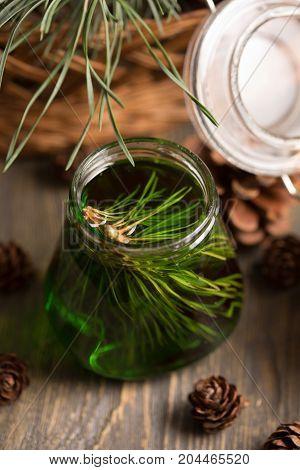 Cedar Honey In A Jar On A Boards With Cedar Cones On A Simple Wooden Background