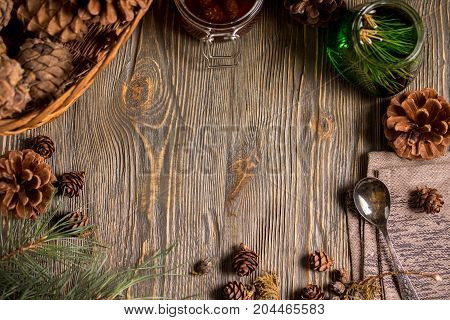 A Jar Of Homemade Jam Made Of Pine Cones And Cedar Green Honey On A Dark Wooden Background. Frame Fo