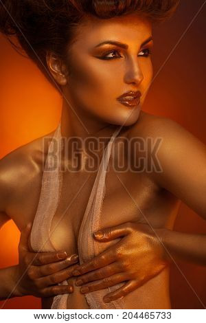 Close up portrait of sexual adult woman in bandage with healthy skin in studio