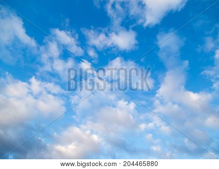 Beautiful clouds on a blue sky as background