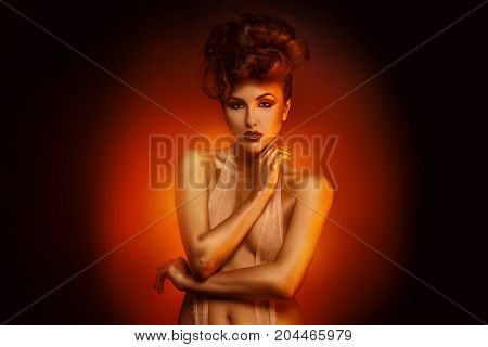 Horizontal portrait of sexy brunette with bandage in studio