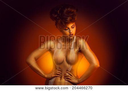 Seductive caucasian adult girl in bandage bra in studio