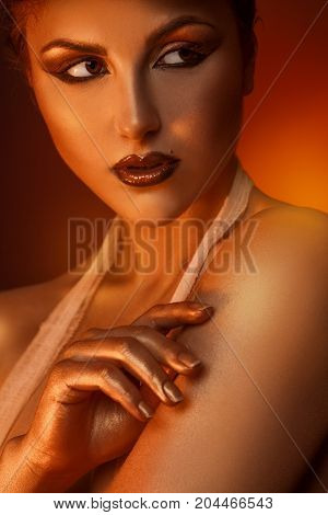 Vertical portrait of pretty adult woman with brown eyes in studio
