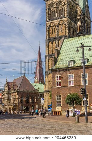BREMEN, GERMANY - AUGUST 23, 2017: Church towers and town hall at the cobblestoned streets of Bremen Germany
