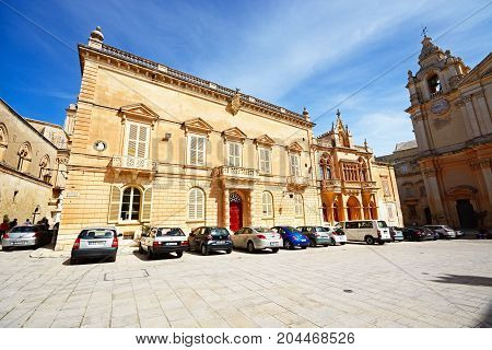 MDINA, MALTA - APRIL 1, 2017 - The Bishops Palace and part of the Cathedral in the Pjazza San Pawl Mdina Malta Europe, April 1, 2017.