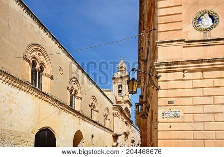 View along Triq Il Villegaignon towards the Annunciation of our Lady church seen from St Pauls Square Mdina Malta Europe.