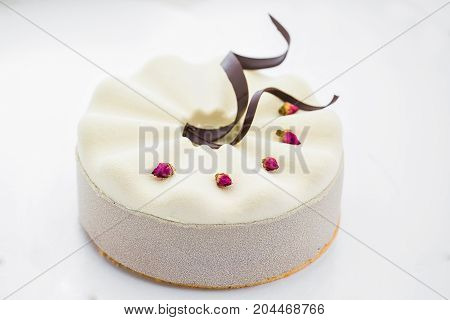 white cake with chocolate icing, food close-up.