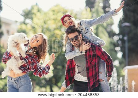 Happy young people having fun together in the park