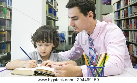 teacher and chirld student learning and drawing in the color book with self book background