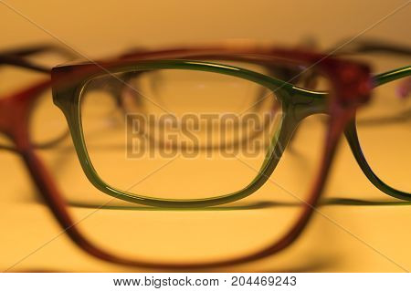 Rimmed eyeglasses closeup on a white background abstract view