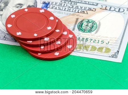 Poker chips on US one hundred dollar bill. Close up.